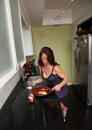 Mature woman Mimi Moore concludes her breakfast by stripping naked
