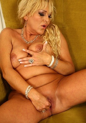Mature blonde woman quickly strips to masturbate her horny vagina