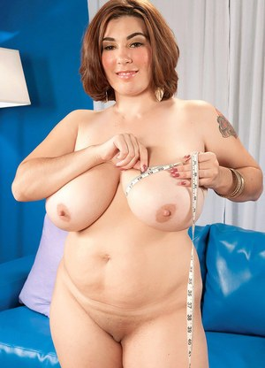 BBW Elaina Gregory unleashes her huge boobs as she gets naked on a blue sofa
