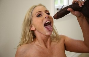 Naked blonde female Christie Stevens gives a long black dick a messy blowjob