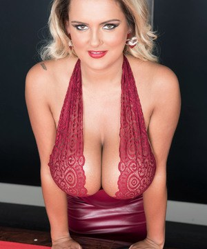 Blonde solo model Katie Thornton unveils her massive tits on top of pool table