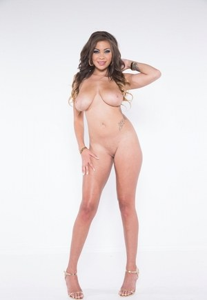 Sexy solo girl Cassidy Banks bares her large boobs as she removes her bra