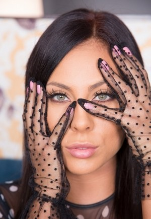 Hot brunette Gianna Nicole poses in see thru gloves and white stockings