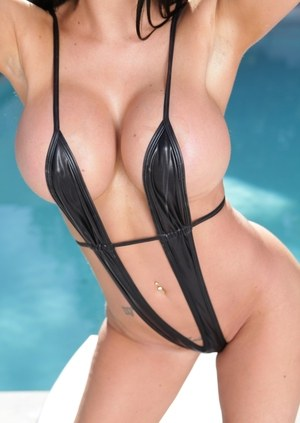 Dark haired MILF Jasmine Jae releases her round tits from swimsuit by pool
