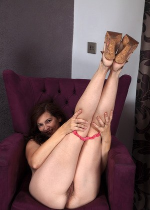 Middle-aged brunette woman Francesca proudly shows off her hairy vagina