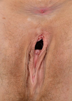 Thin middle-aged woman shows off her gaping asshole and vagina