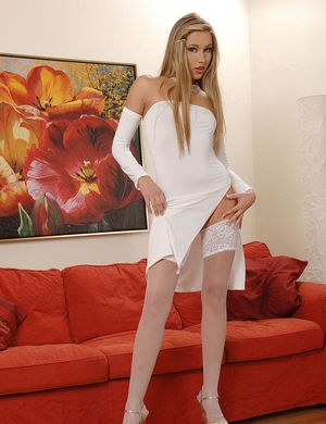 Beautiful female Cherry Jul removes her all white outfit and high heels