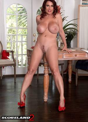 Leggy MILF Goldie Blair slips off her dress and red lingerie in a chair