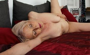 Older lady Shiela parts her hairy bush before fervently masturbating