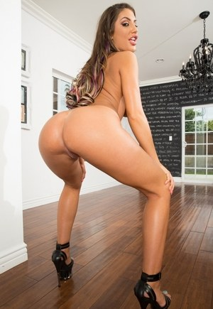 Hot solo girl August Ames displays her generous assets as she removes clothes