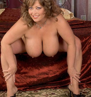 BBW Savannah Phair removes her silk robe and lingerie to pose naked