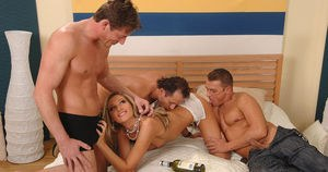 Sexy MILF Cherry Jul plays spin the bottle with 3 men on her bed