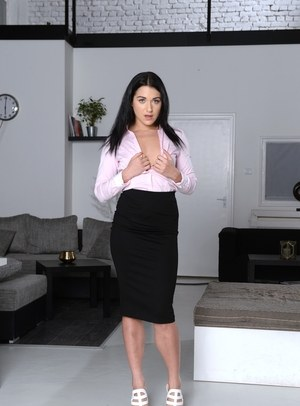 Dark haired female Jess Lincoln removes her long black skirt to pose nude