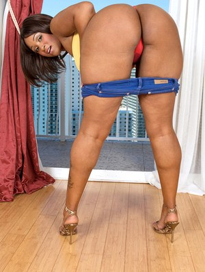 Black chick Kara Kane shows her big ass during vaginal and anal toying