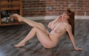 Thick redhead Penny Pax works her nude body clear of overalls and underwear