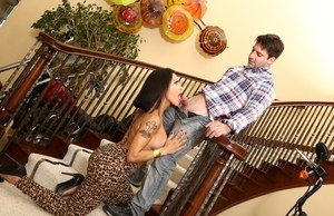 Brunette tranny TS Foxxy does topless while sucking cock on staircase