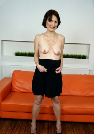 Short haired granny Alice Sharp bares her saggy tits as she strips naked