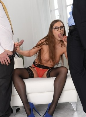 Glasses wearing female sucks off two men at the same time in black stockings