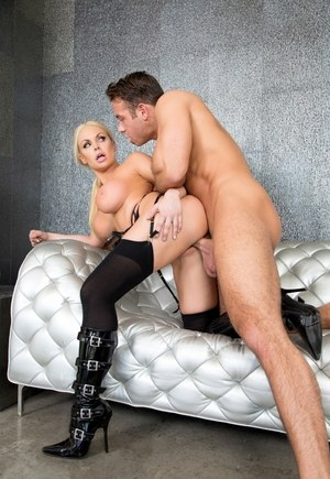 Blonde bombshell is stripped to hose and boots before getting fucked