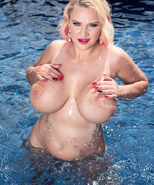 Solo girl Dolly Fox lets her round boobs free from bikini in swimming pool