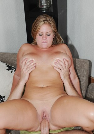 Busty blond plumper Ellie May rides her guy's cock until catching jizz on tits