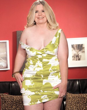 Older BBW Jemini Jordan strips off her dress and white panties on leather sofa