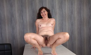 Older woman Francesca shows off her all natural pussy after a little tease