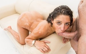 Pornstar Abella Danger gets all oiled up before blowing a massive cock
