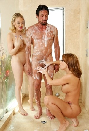 2 female massage attendants soap up a client in tub before sucking his cock