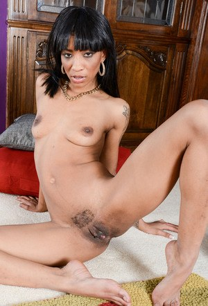 Black solo girl September Reign shows off her bald pussy for the first time