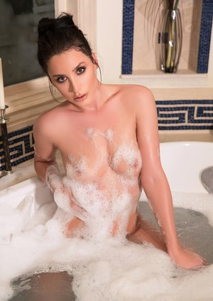 Sexy brunette female Kendra Cantara climbs out a bathtub in a teasing manner