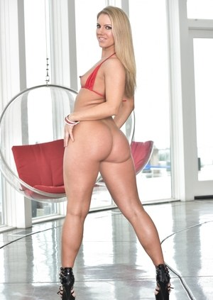 Blonde model Candance Dare rocks her big ass after slipping off hi cut shorts