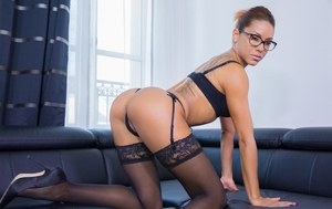 Solo model Rose Valerie removes her lingerie and then her glasses