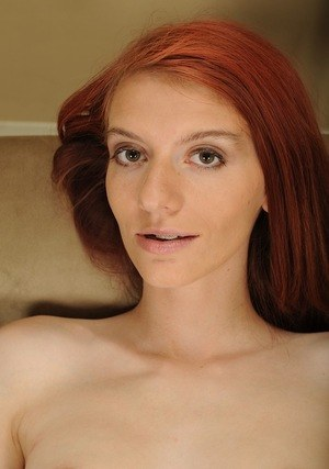 Pale redhead slips off her skirt on way to posing nude for the first time