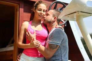 Busty teen girl Antonia S gets fucked outside on a houseboat