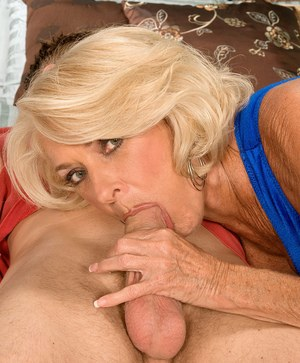 Big boobed granny Georgette Parks sucks off a younger mans huge cock