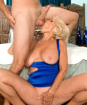 Big boobed granny Georgette Parks sucks off a younger man's huge cock