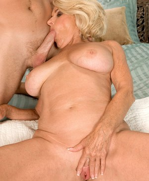 Hot cougar Georgette Parks seduces a young man in a short blue dress