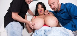 Brunette chick Roxi Red exposes her mega tits before fucking two guys at once