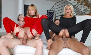 Beautiful females in crotchless clothes do a hard foursome fuck