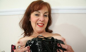 Sexy granny Georgie slips off her latex dress before stretching her cunt lips