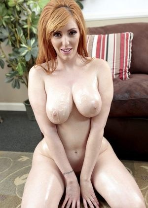 Busty redhead pornstar Lauren Philips sucks a cock until it blows a jizz load