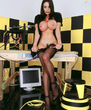 Raven haired solo model pulls out her massive tits wearing black nylons