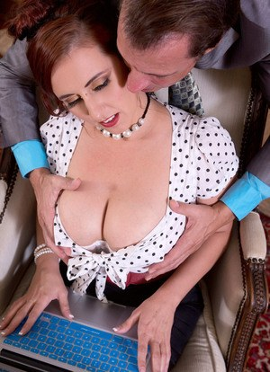 Classy secretary Demmi Valentine seduces her boss with her ample cleavage
