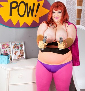Redhead BBW Kitty McPherson strips off her cosplay outfit to pose nude
