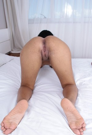Ebony amateur Morgan Michele slips off her bikini to play with her horny pussy