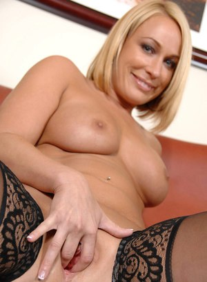 Middle-aged blonde Mellanie Monroe uncovers her nice tits before masturbating