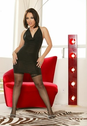 Sexy solo model Kristina Rose works free of a black dress atop a red chair
