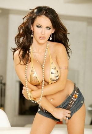 Hot Latina girl Jenna Presley peels off bikini top and microskirt to pose nude