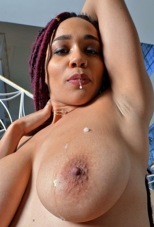 Black amateur drools onto her big tits before showing her wide open snatch